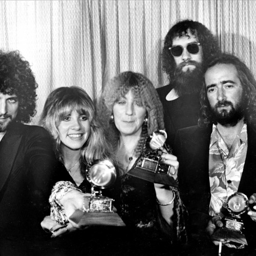 """Members of Fleetwood Mac, from left, Lindsey Buckingham, Stevie Nicks, Christine McVie, Mick Fleetwood, wearing sunglasses, and John McVie, pose with their Grammys at the annual Grammy Awards in Los Angeles, Ca., Feb. 23, 1978.  The group won in the category of Album of the Year for """"Rumours.""""  (AP Photo)"""